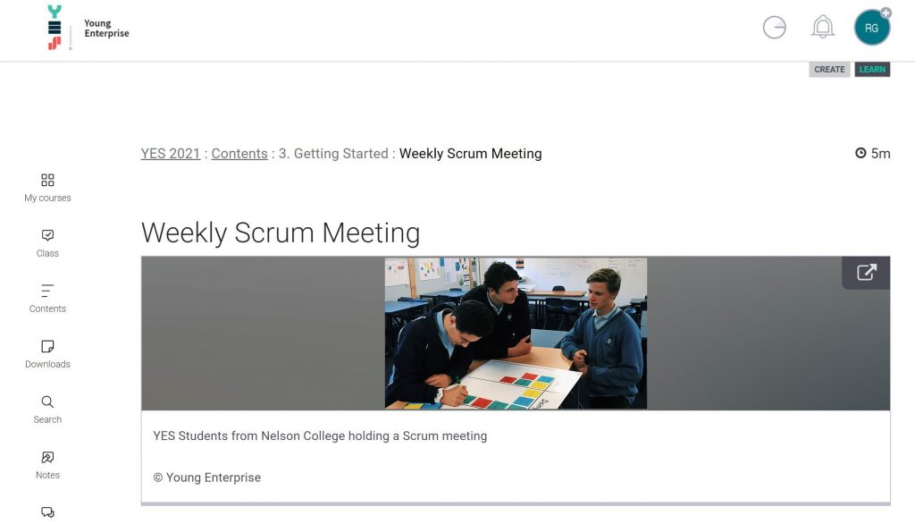 Example from YES iQualify for Schools online learning course showing boys in a meeting, titled 'Weekly Scrum Meeting'.